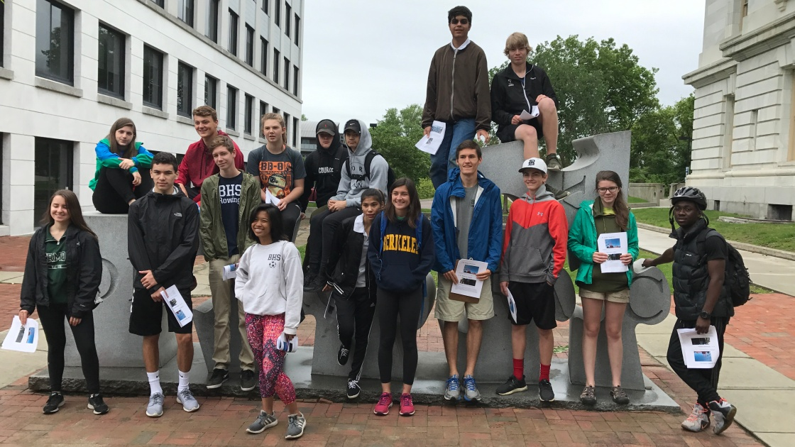 "Students in front of ""Democracy"" sculpture in downtown Burlington"
