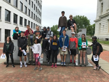 """Students in front of """"Democracy"""" sculpture in downtown Burlington"""