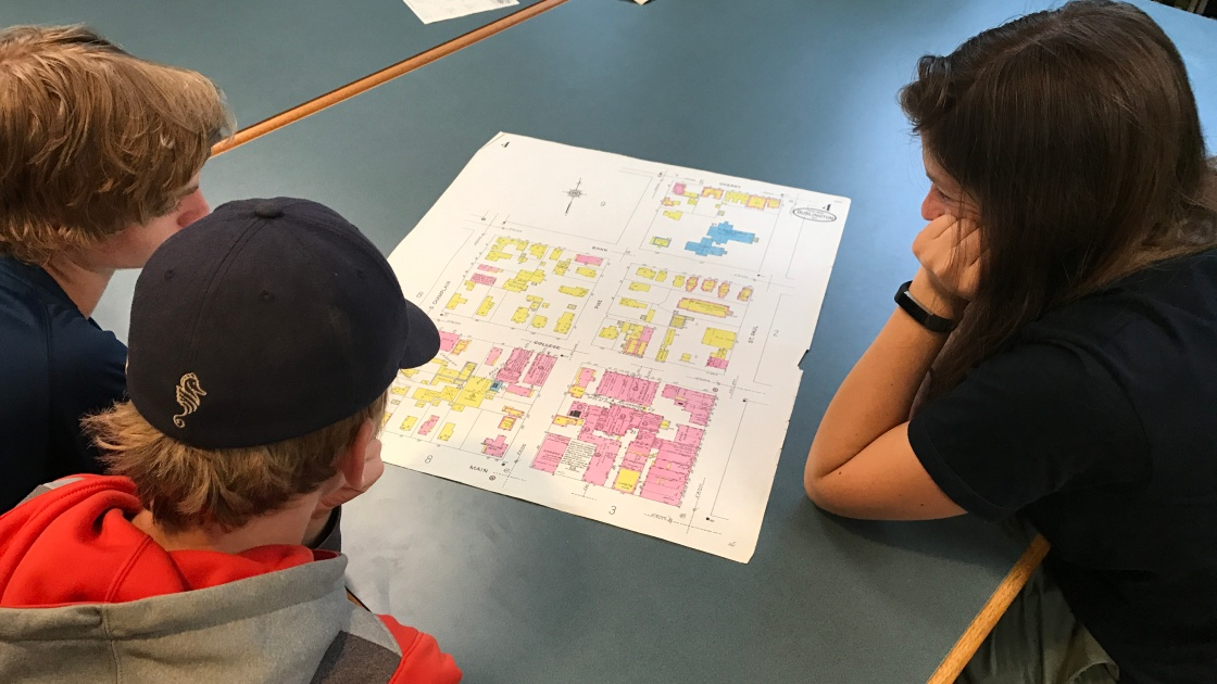 Students studying map of Burlington
