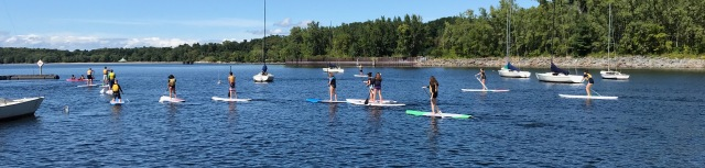 Students paddle on the lake.
